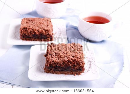 Chocolate crumble cake with cherry filling served