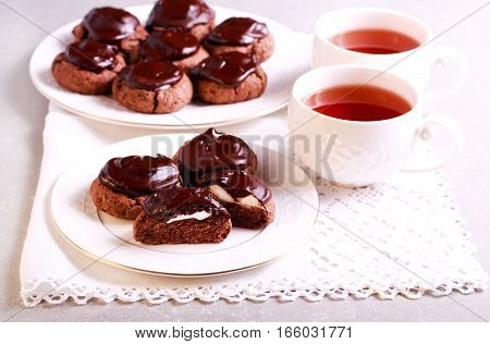 Chocolate surprise cookies with marshmallow filling on plate