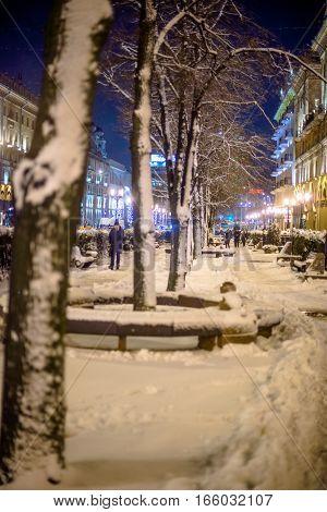 Minsk, Belarus, JANUARY 4,2017: People walk through the city center on a winter evening in Minsk, Belarus.