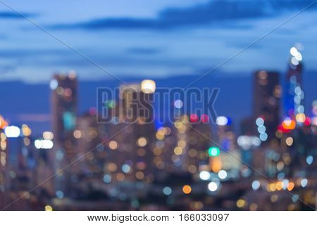 Twilight blurred lights cityscape office building downtown abstract background