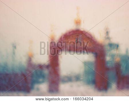 red bricks church arch gate, winter blur