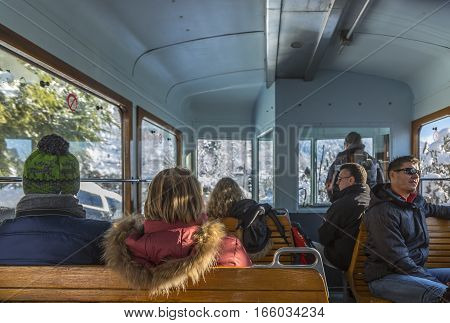 MotivonFrance - December 30 2017: Unidentified tourists are in the Tramway of Mont Blanc on the way to Col de Voza on December 30 2017.This is the highest tram in France connecting Saint Gervais with Nid d'Aigle station at the Bionnassay glacier.