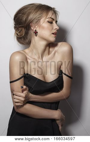 tender girl with bare shoulders. The hair gathered up. Classic. Portrait profile