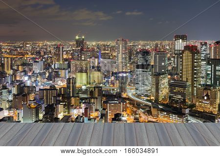 Opening wooden floor night view Osaka city central business downtown Japan