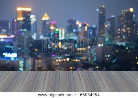 Open wooden floor abstract blurred lights office building night view