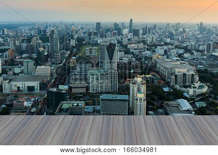Opening wooden floor aerial view Bangkok city business downtown and skyline background Thailand