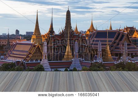 Open wooden floor The Emerald BuddhaGrand palace in Bangkok Thailand Wat Phra Kaew Temple during sunset