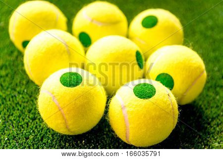 tennis ball on green background close up.