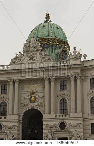 VIENNA, AUSTRIA - JANUARY 3 2016: Architectural detail of the imperial facade of Hofburg Palace in Vienna with its green dome