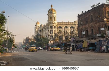 KOLKATA, INDIA -JANUARY 15, 2017: Chowringhee city road at Esplanade Dharmatala an important landmark with a mix of heritage buildings and architecture.