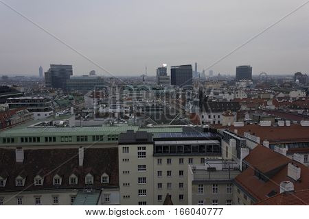 VIENNA, AUSTRIA - JANUARY 3 2016: Overview of Vienna skyline in a cloudy day from the top of the cathedral