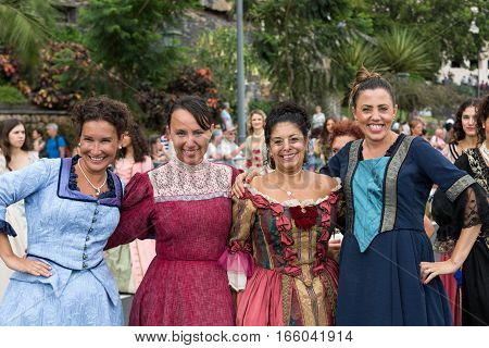 FUNCHAL MADEIRA PORTUGAL - SEPTEMBER 4 2016: Group of women in historical fashion dress durnig historical and ethnographic parade of Madeira Wine Festival in Funchal. Madeira Portugal