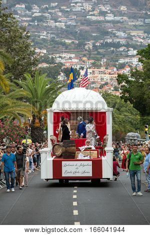 FUNCHAL MADEIRA PORTUGAL - SEPTEMBER 4 2016: Men in historical fashion dress raise toasts durnig historical and ethnographic parade of Madeira Wine Festival in Funchal. Madeira Portugal