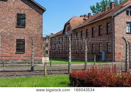 AUSCHWITZ-BIRKENAU CONCENTRATION CAMP, KRAKOW, POLAND - CIRCA JUNE 2012: View of territory of with electric barbwire fence and watch towers