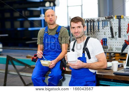 Two Worker In Factory Have A Break