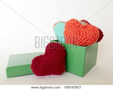 Hand Made Of Colorful Hearts Made Of Wool And Fabric
