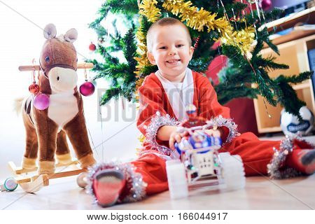 The child in a suit of the Christmas gnome High Key