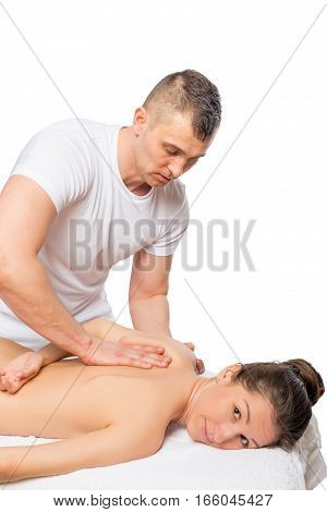 Woman And Masseur, Shot On A White Background