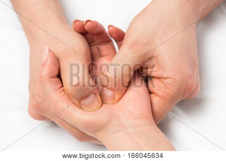 Massage Therapist Doing Massage Of Hands, Pressure On Certain Points
