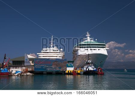 KUSADASI, GREECE - MAY 17, 2016: Two cruise ships wait for returning passengers at Kusadasi, the gateway to Ephesus