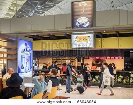 Hong Kong, China - Oct 30, 2016: Inside Hong Kong International Airport - South side dinning area. This is a busy area, featuring the popular Tasty Congee and Noodle Wantun Shop.