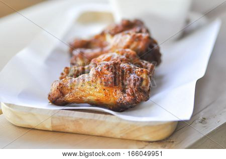 fried chicken or grilled chicken in wooden plate