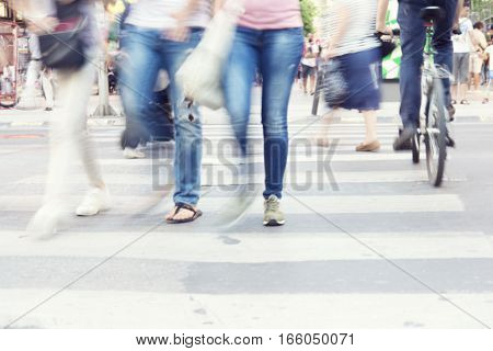 filtered blur abstract people background unrecognizable silhouettes of people walking on a street