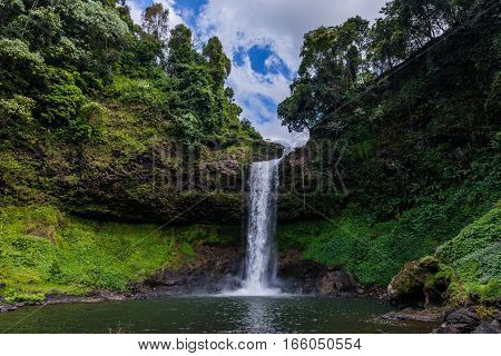 waterfalls inside the pakse forest in Laos during a sunny day