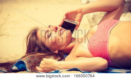 Woman On Beach Talking By Mobile Phone.