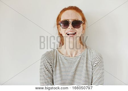 Headshot Of Happy Beautiful Fashionable Young Redhead Woman Wearing Trendy Sunglasses And Striped Lo