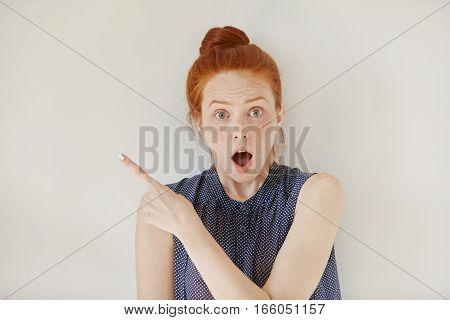 Human Face Expressions, Emotions And Feelings. Astonished And Shocked Young Redhead Female In Sleeve