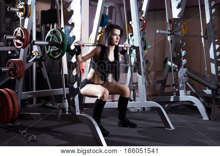 Fitness Brunette Woman Exercising With Barbell In Gym.