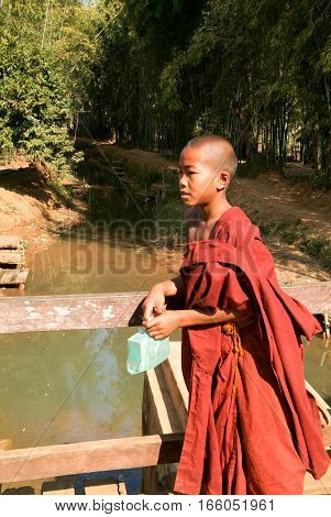 Indein Myanmar - 15 January 2010: Young monk at the weekly market at Indein on Inle Lake in Myanmar