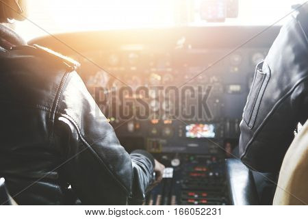 People, Occupation And Aerospace Concept. Captain And Copilot Wearing Headset And Outfit Flying Comm