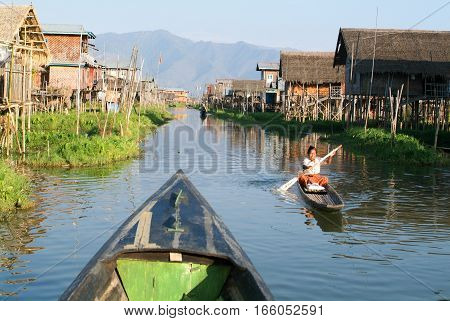 Maing Thauk (lake Inle) Myanmar - 15 January 2010: Woman on rowing a boat at the village of Maing Thauk on lake Inle Myanmar