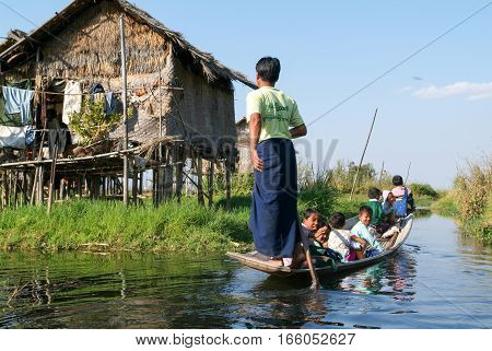 Maing Thauk (lake Inle) Myanmar - 14 January 2010: People on rowing a boat at the village of Maing Thauk on lake Inle Myanmar