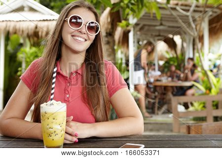 Beautiful Young Woman With Charming Smile Having Happy And Cheerful Expression, Enjoying Holidays In