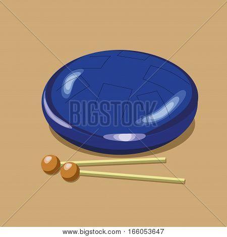 Vector steel tongue drum with sticks on the light brown background