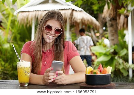 Happy Woman Making Video Call To Her Boyfriend, Using Free Wi-fi On Her Mobile Phone, Looking At Scr