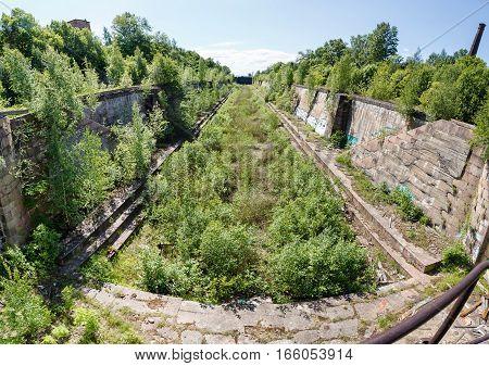 ruined Petrovsky dry dock in Kronstadt in a summer day. Saint-petersburg Russia