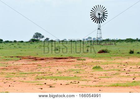 Stainless steel windmill used as a water pump in the Tsavo park savannah in Kenya