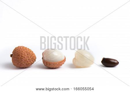 Several different lychees on a white background