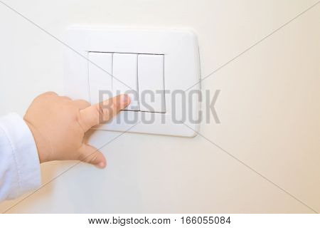 Adorable Little Boy Child Turning On The White Light-switch