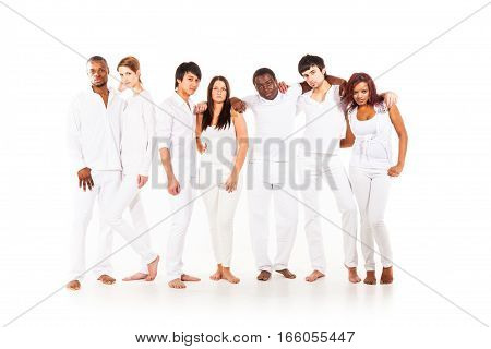 Studio shot of multi-ethnic group of young adults
