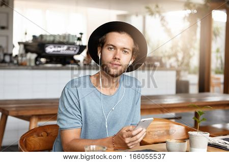 People, Leisure And Modern Technology. Attractive Young Caucasian Man Wearing T-shirt And Stylish Ha