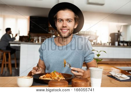 People, Lifestyle, Health And Nutrition. Handsome Young Bearded Male Eating Healthy Food With Knife