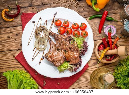 grilled beef steak on the grill on a wooden table