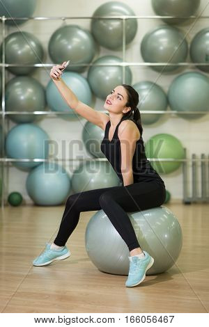 Woman involved in sports with a ball and rest