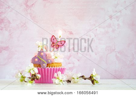 homemade birthday cake with whipping cream and spring blossom
