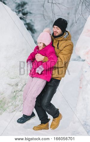 father and little daughter spend time together